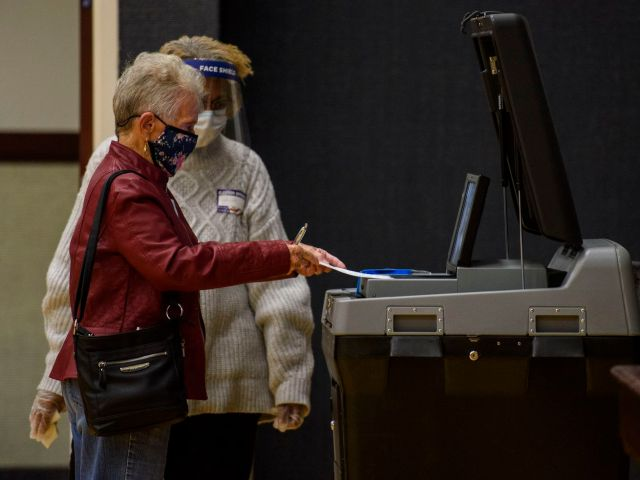 Dorothy Higginbotham, 90 years old, places her ballot into a tabulating machine on Election Day at Church of Jesus Christ of latter-day Saints on November 3, 2020 in Fayetteville, North Carolina.