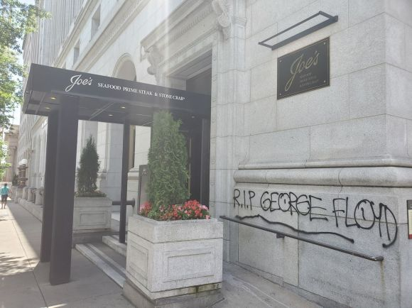 "Graffiti on the wall at the high-end surf and turf restaurant Joe's Seafood reads ""R.I.P. George Floyd."""