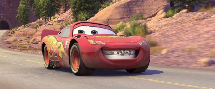 a red racecar flashes a bug-splattered grin