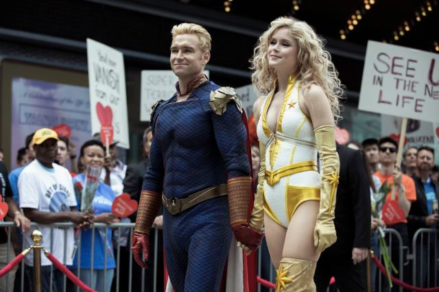 Homelander and Stormfront walk along an anti-superhero demonstration in The Boys season 2
