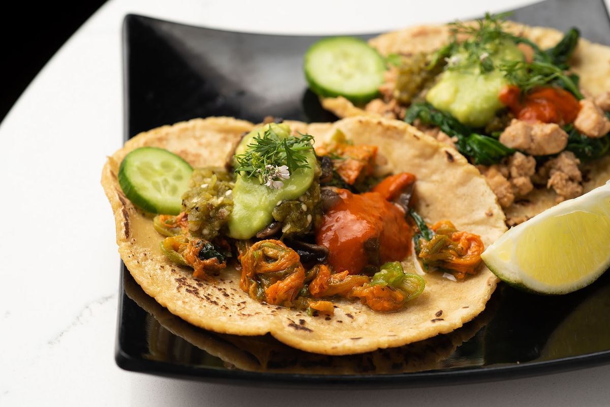 Vegetarian tacos with squash flower and mushroom spinach at Lanea