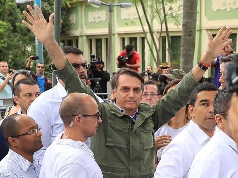 Jair Bolsonaro, a far-right politician, just won Brazil's presidential election. Here he gestures after casting his vote on October 28, 2018 in Rio de Janeiro.