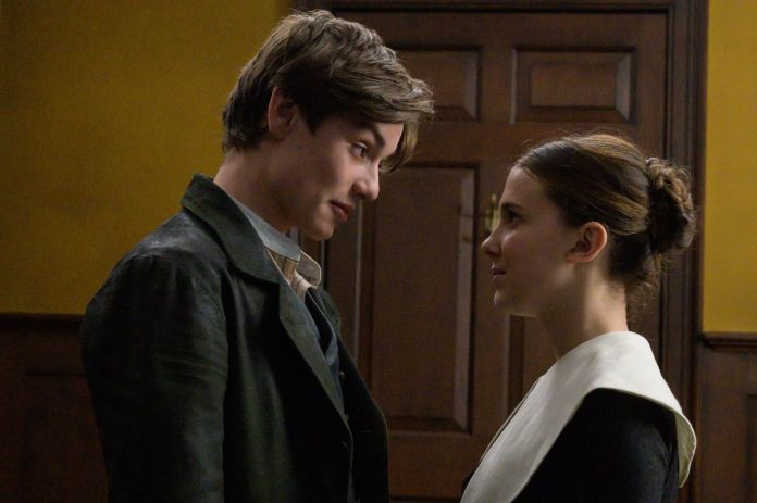 a young man and woman speak to each other