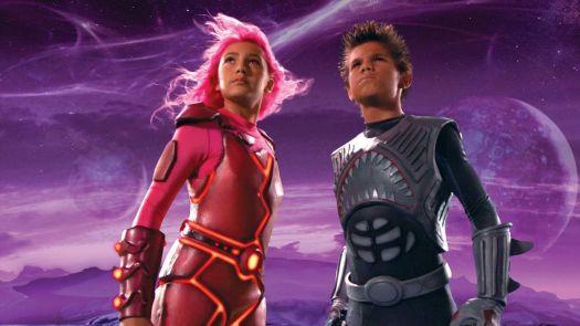 Two kids dressed as superheroes.