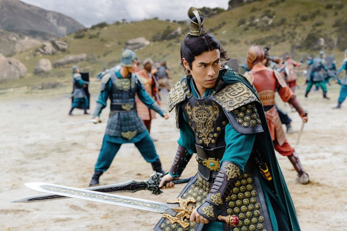 A soldier in period Chinese costume wields two swords in Netflix's Dynasty Warriors