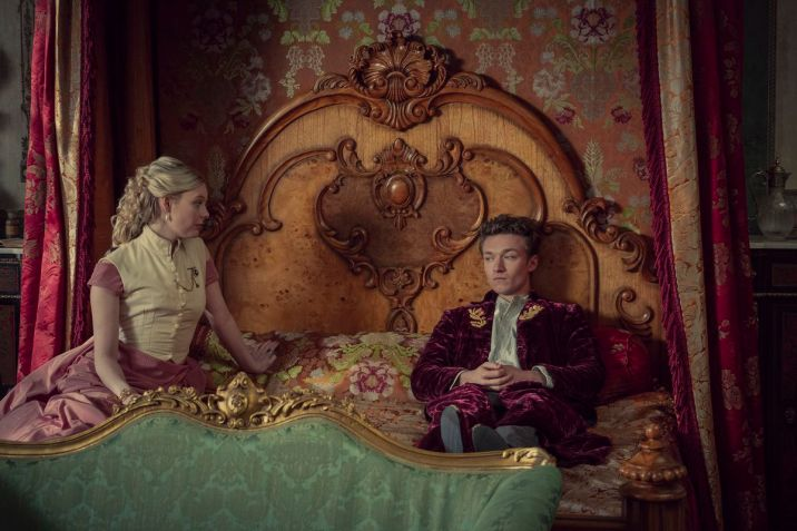 Prince Leopold sits fully dressed and contemplative in bed in The Irregulars.