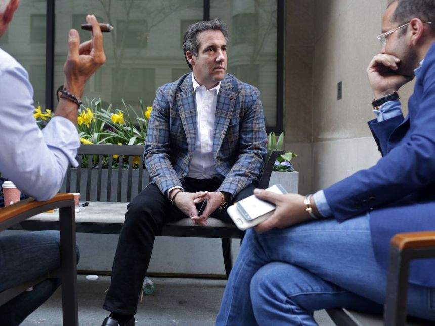 Michael Cohen skipped a court hearing to talk with friends outside in New York City on Friday.