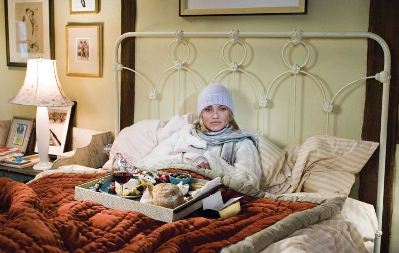 Cameron Diaz sits in bed with a tray of food