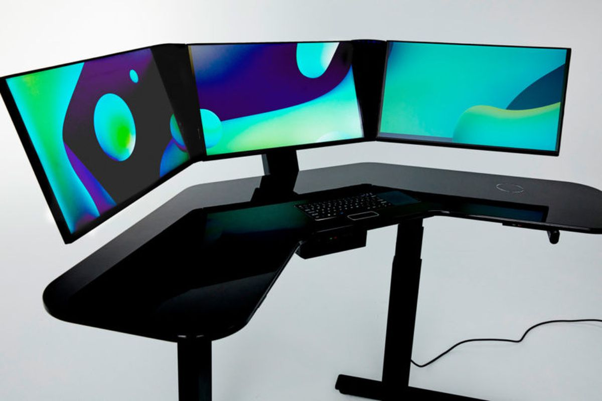 This allinone smart desk has three screens and a built