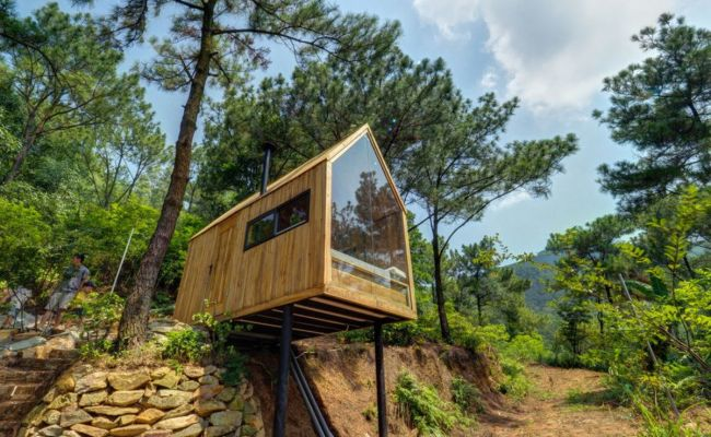 Bare Bones Tiny House With Glass Wall Perches On Stilts