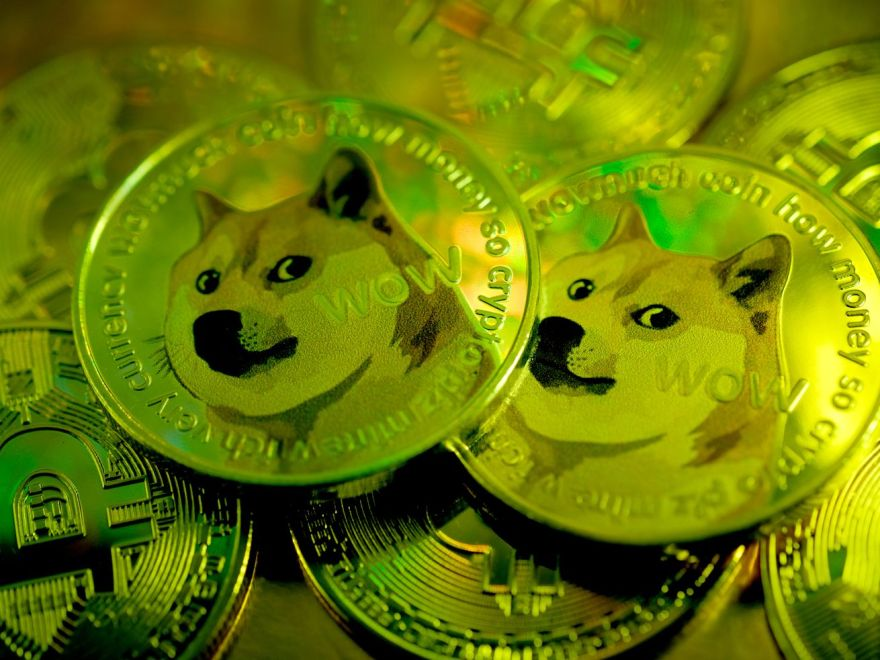 A pile of coins with a Shiba Inu dog on them.