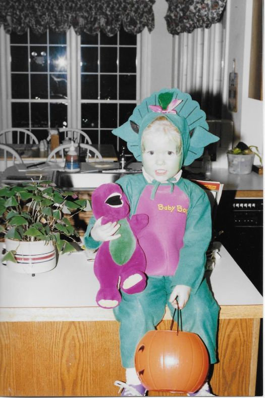 a little girl dressed as baby bop