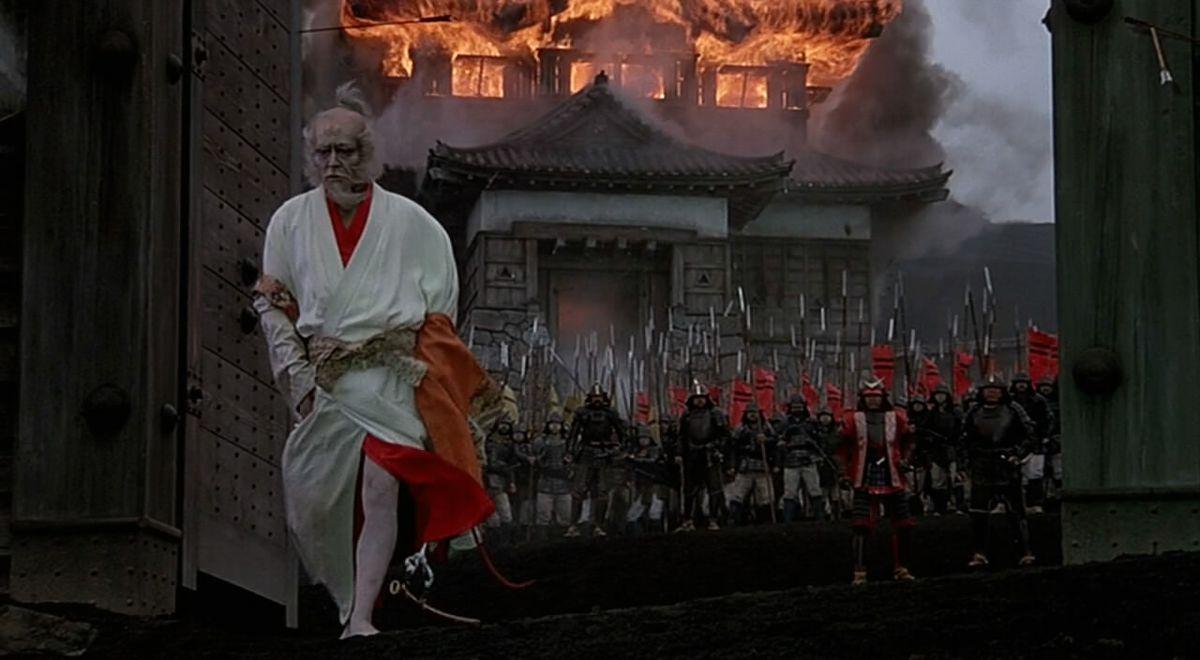 Lord Hidetora Ichimonji walks dejectedly from his burning estate