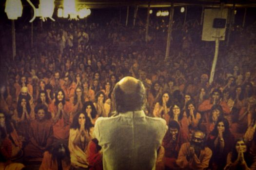 <em>Cult leader Bhagwan Shree Rajneesh and his followers in India.</em>