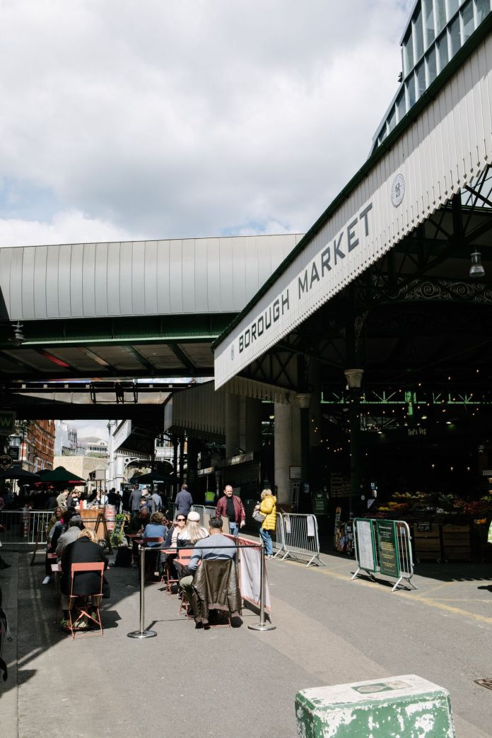 Customers seated outside restaurants in Borough Market