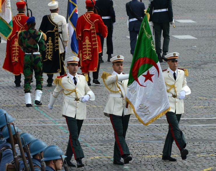 Algerian soldiers parade on the Champs-Elysees during the annual Bastille Day military parade on July 14, 2014, in Paris, France.