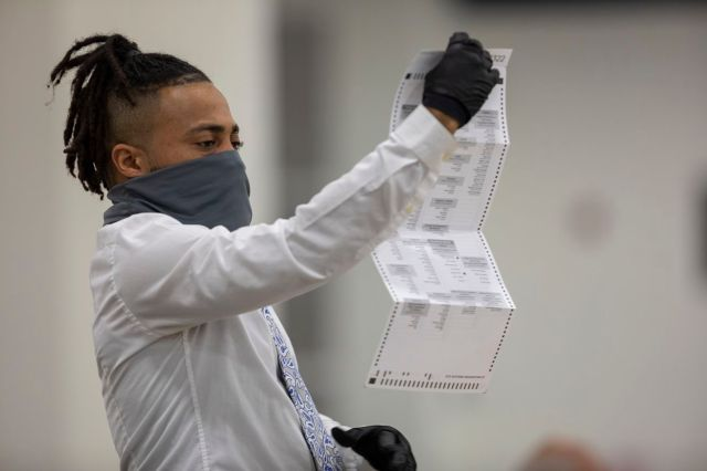 Michigan Election Workers Continue To Work Absentee Ballots