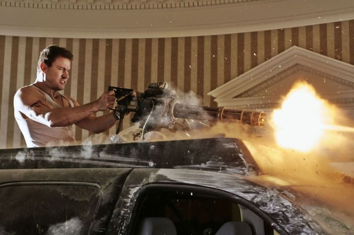Channing Tatum as John Cale firing a gatling gun in the Oval Office in White House Down.