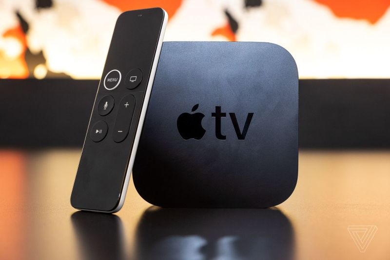 The Apple TV 4K, the best streaming device user experience, on a table with the Siri remote.