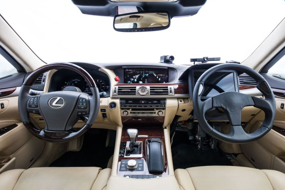 medium resolution of toyota s new self driving car has two steering wheels to prevent robot joyriding