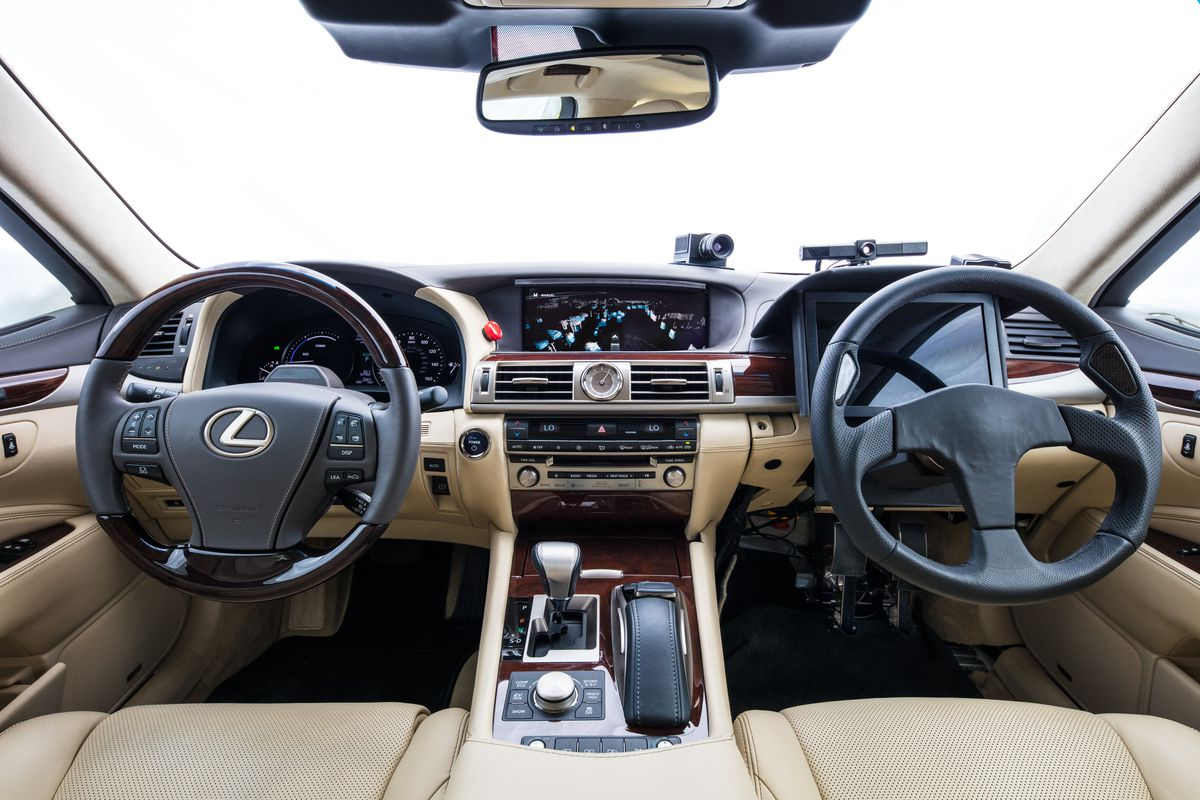 hight resolution of toyota s new self driving car has two steering wheels to prevent robot joyriding