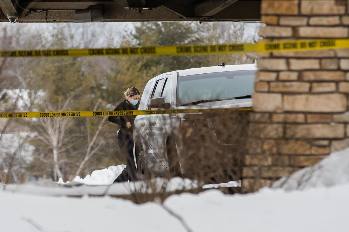 A police officer walks outside the Indian Lakes Hotel at 250 W. Schick Road Saturday morning after a fatal shooting.