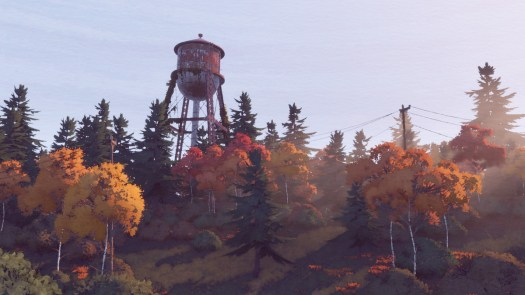 A landscape scene with a water tower in the background