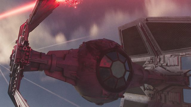 A cropped version of the image of a TIE Interceptor being damaged by an X-Wing over Var-Shaa.