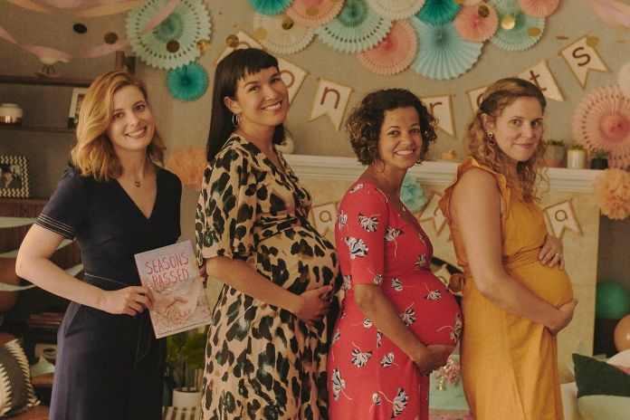 Gillian Jacobs with a group of pregnant characters in I Used To Go Here
