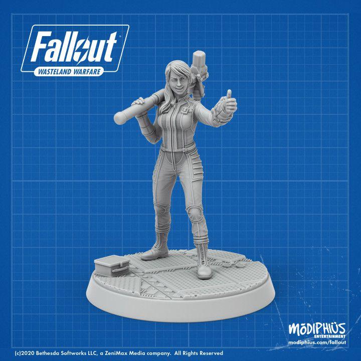 Un rendu d'un modèle Vault Girl, vêtu de la combinaison emblématique de coffre-fort et donnant le signe du pouce levé.