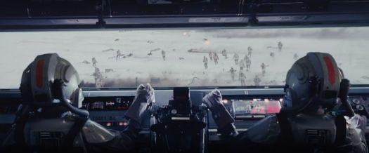 Two AT-AT pilots at the controls of a massive AT-AT walker.