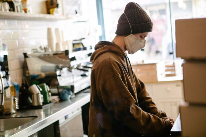 A service staff working behind the counter of Kahaila, a cafe
