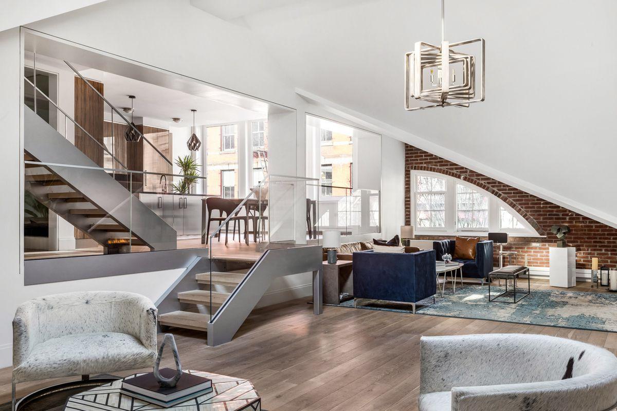 Chic asymmetrical loft atop historic Soho buildings seeks