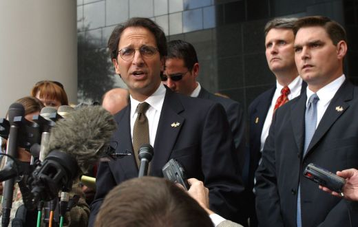 An image of Andrew Weissmann being interviewed by reporters