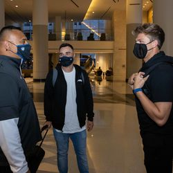 BYU quarterback Zach Wilson, right, chats with BYU head coach Kalani Sitake, left, and BYU passing game coordinator / WR coach Fesi Sitake ahead of the NFL Draft 2021 on Thursday April 29, 2021 in Cleveland, Ohio.