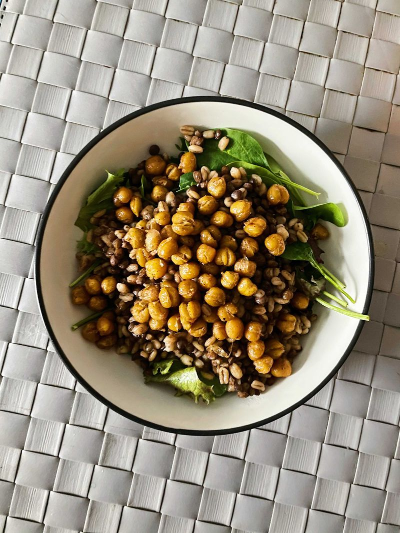 a salad topped with chickpeas.