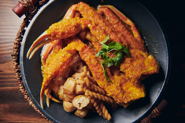 Spicy crab boil with Chinese breadsticks