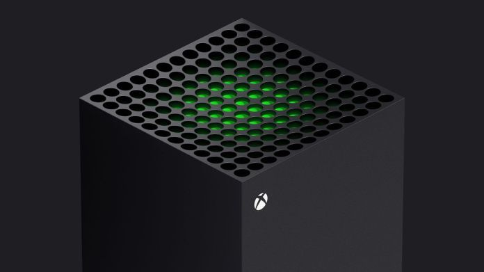 a 3⁄4 view of the top of the Xbox Series X, with a green piece of plastic visible just beneath the system vents