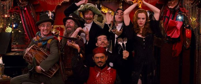 The cast of Moulin Rouge poses in the middle of a dance number