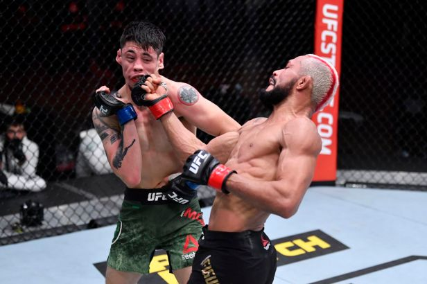 Deiveson Figueiredo vs. Brandon Moreno ends in majority draw following  potential Fight of the Year at UFC 256 - MMA Fighting