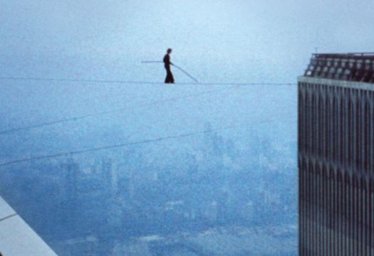 Philippe Petit balancing between the Twin Towers