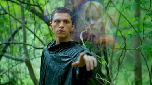Tom Holland touching an apparition of Daisy Ridley in Chaos Walking
