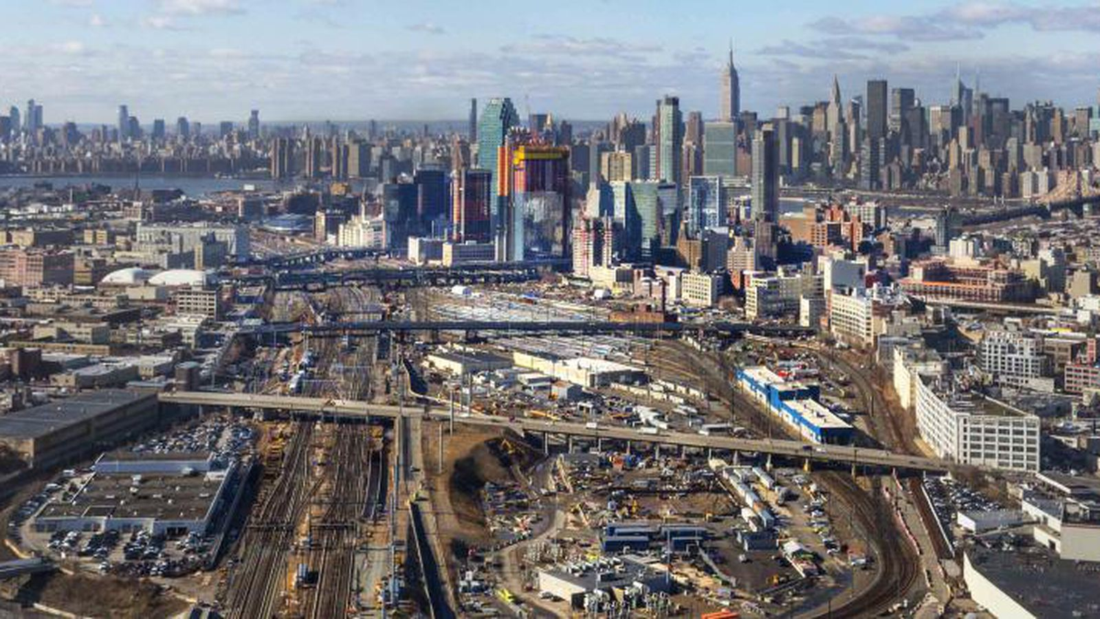 City presents three scenarios for megaproject over Sunnyside railyards  Curbed NY
