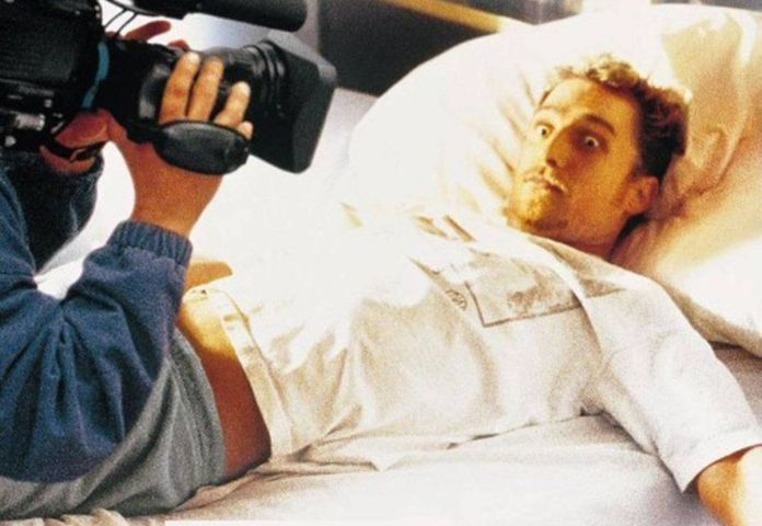 A wide-eyed Matthew McConaughey, lying in bed, looks up at a too-close camera lens in EDtv