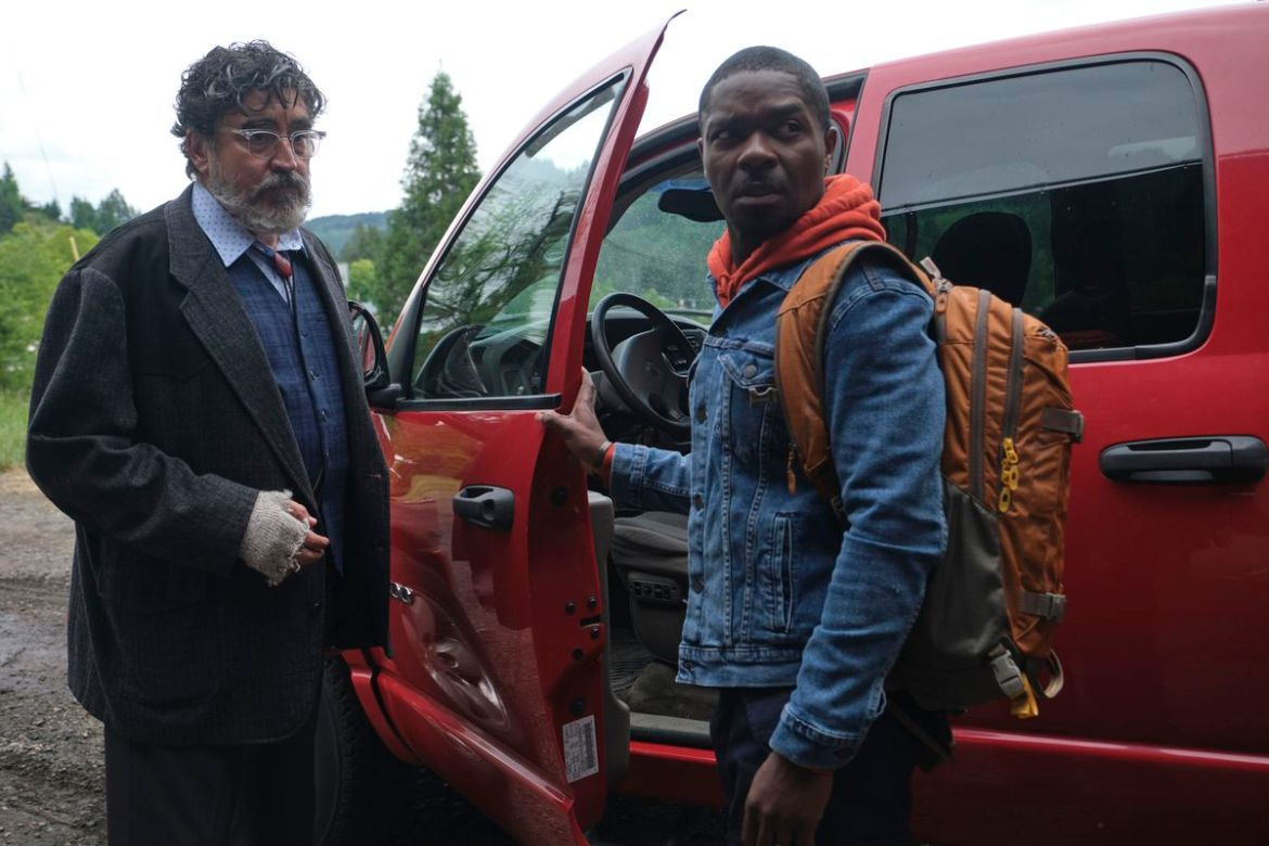 Alfred Molina and David Oyelowo stand by a red truck looking concerned in The Water Man.