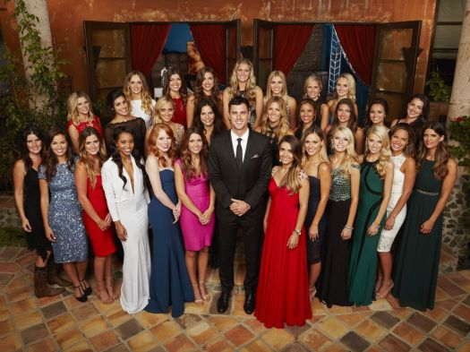 Ben Higgins stands in front of the 25 women tasked with wooing him