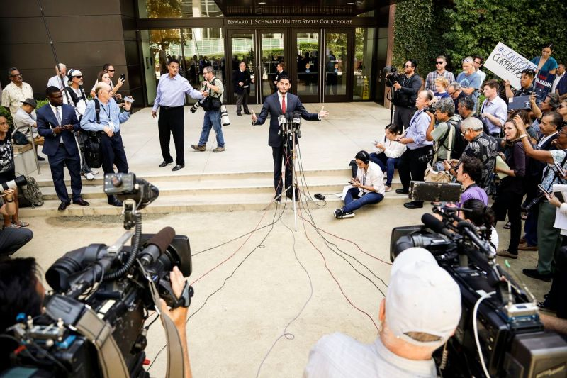 Democratic congressional candidate Ammar Campa-Najjar (center) speaks in front of a federal courthouse as reporters wait for the end of an arraignment for Duncan Hunter and his wife, on Aug. 23, 2018, in San Diego.