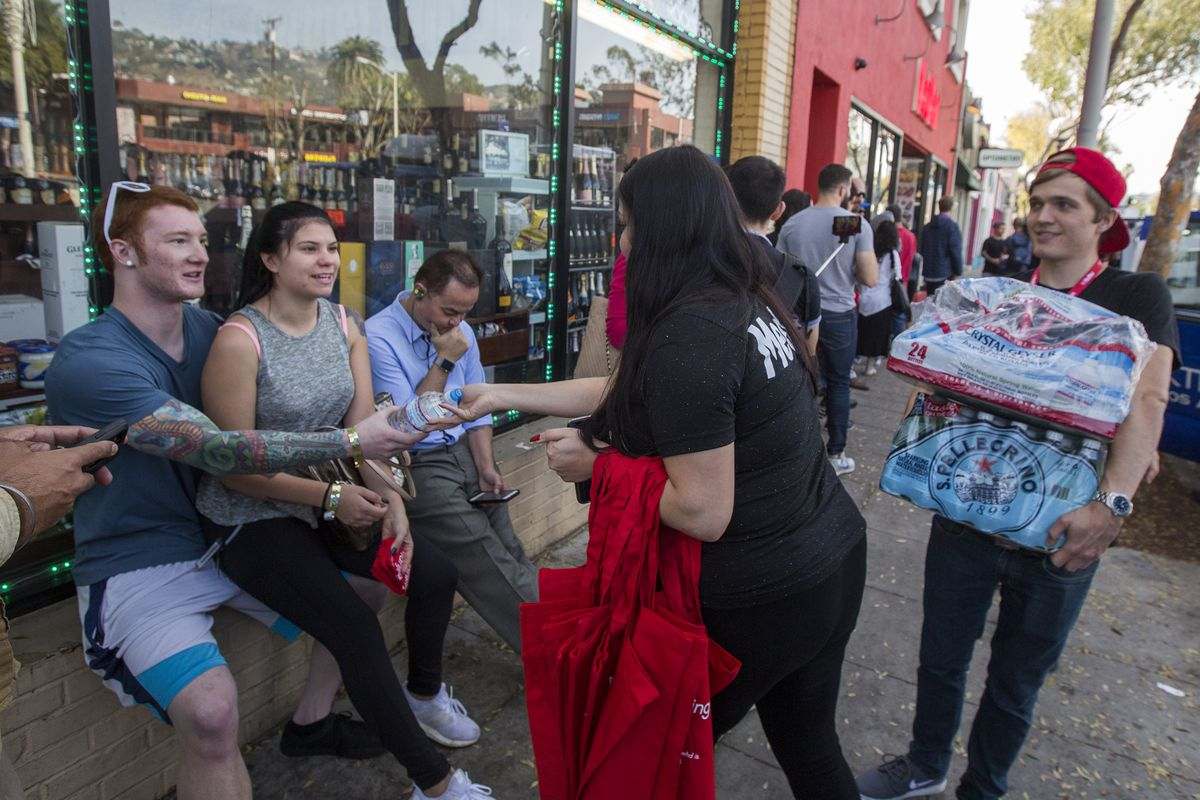 Employees Give Water To People Waiting In Line To Get Into Medmen In West  Hollywood. The Business Is One Of Four In The Los Angeles Area That Began  Selling