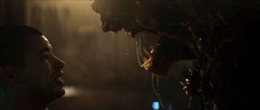 A prisoner faces a drooling monster in a still from The Callisto Protocol's cinematic trailer