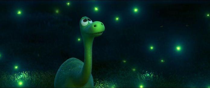 green dinosaur looking up as fireflies sparkle